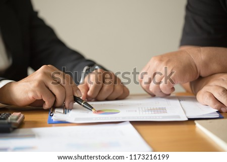 Business team are meeting and discussing marketing plan strategy report analyzing financial at business document, Teamwork process #1173216199