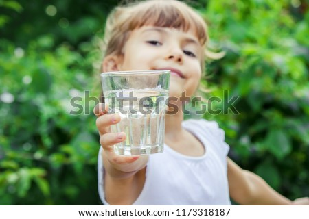 child glass of water. selective focus. Children #1173318187