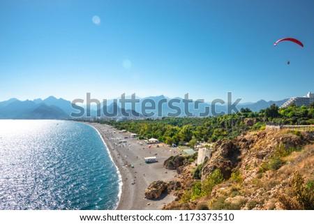 Panoramic bird view of Antalya and Mediterranean seacoast and beach with a paraglider, Antalya, Turkey, Autumn #1173373510