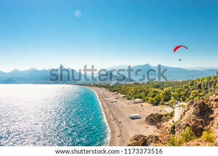 Panoramic bird view of Antalya and Mediterranean seacoast and beach with a paraglider, Antalya, Turkey, Autumn #1173373516