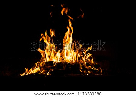 Fire flames isolated on black background. High resolution wood fire flames collection smoke texture background concept image.