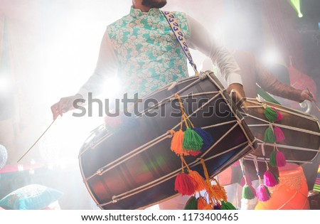 Dhol player during sangeet mehndi party #1173400465