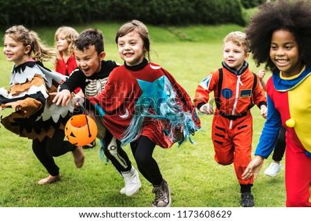 Little children trick or treating on Halloween #1173608629