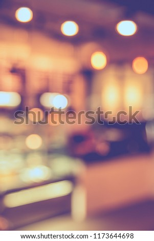 Abstract blur image of  Restaurant or Cafe  with bokeh for background usage . (vintage tone) #1173644698