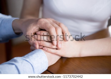 Close up of man and woman holding hands showing love and empathy, couple reconciled give support or comfort to spouse, male caress female expressing understanding and care. Good relationships concept #1173702442