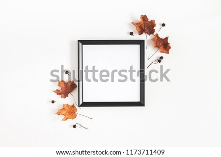 Autumn composition. Photo frame, dried leaves on white background. Autumn, fall, halloween concept. Flat lay, top view, copy space, square