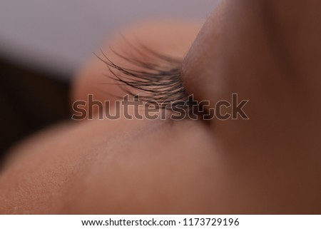 view of a small baby's eyelashes and eyelids  #1173729196