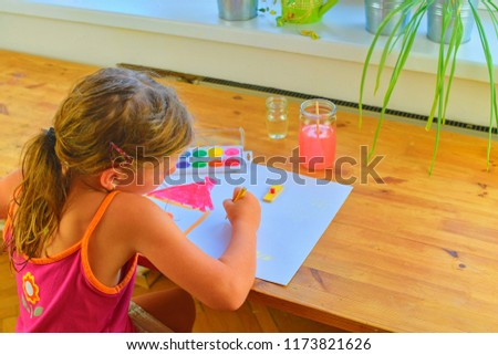 Cute little girl painting picture of house. Mortage concept. Selective focus, small DOF. #1173821626