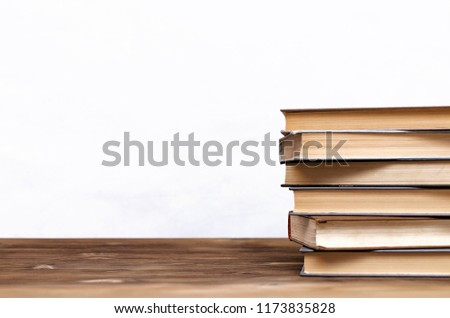 Stack of books on the school desk isolated on white background. #1173835828