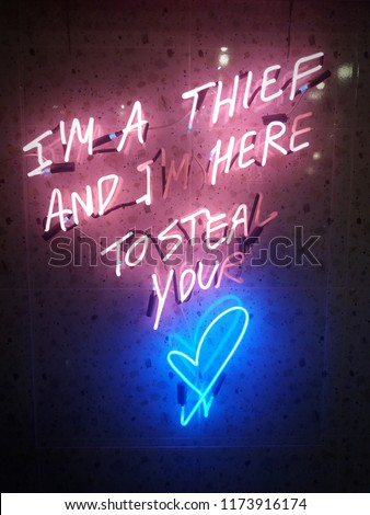 neon lighting text says i'm a thief and i'm here to steal your love