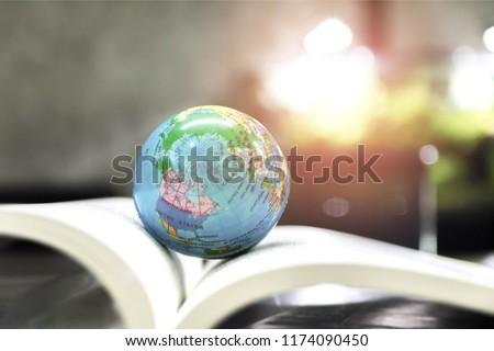 World globe on text book.     International education school Concept.  #1174090450