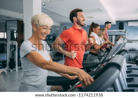 People running on a treadmill at the gym. #1174211938