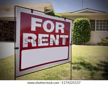 For Rent Sign in front of a house.