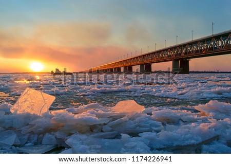 Ice drift on the Amur river.  Amur bridge, Trans siberian railway. Khabarovsk, far East, Russia. #1174226941