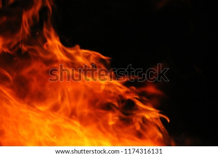 Blurred illustration of burning fire flame. blaze fire flame texture on black background #1174316131