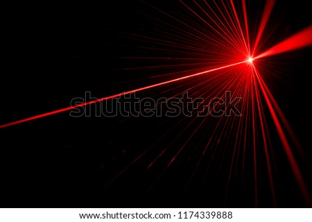 Red laser beam light effect on black background Royalty-Free Stock Photo #1174339888