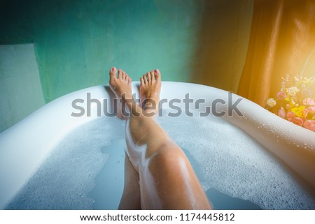 Woman's feet with foam bubble bath in luxury bathtub, Happiness and relaxing concept. -Vintage tone. #1174445812