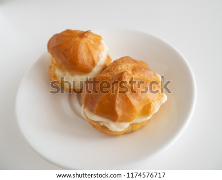 Profiteroles with custard, side view #1174576717