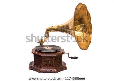 Gramophone is an Music device. Old gramophone with plate or vinyl disk on wooden box. Antique brass record player. Gramophone with horn speaker. Retro entertainment concept. #1174588666