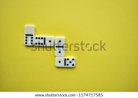 domino pieces on a yellow background #1174717585