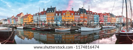 Nyhavn at sunrise, with colorful facades of old houses and old ships in the Old Town of Copenhagen, capital of Denmark. #1174816474