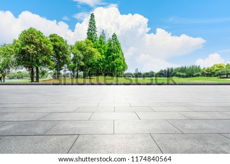Empty city square floor and green woods scenery #1174840564