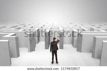 Businessman choosing between entrances in a middle of a maze #1174850857