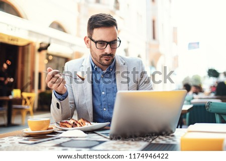 Young businessman doing his freelance job in cafe. #1174946422