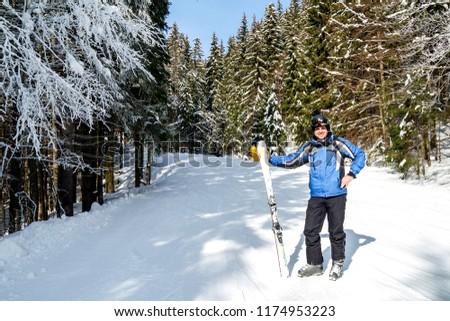 Young handsome man in winter sportswear looking away, wearing big mirrored ski mask. #1174953223
