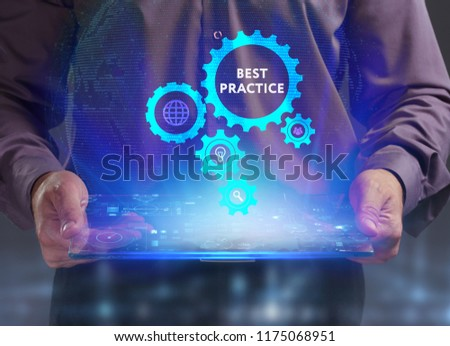 The concept of business, technology, the Internet and the network. A young entrepreneur working on a virtual screen of the future and sees the inscription: Best practice #1175068951