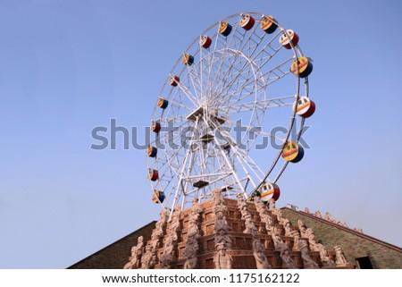 Big Wheel Swing in theme park #1175162122