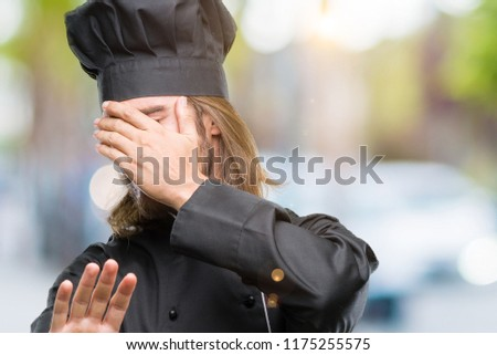 Young handsome cook man with long hair over isolated background covering eyes with hands and doing stop gesture with sad and fear expression. Embarrassed and negative concept. #1175255575