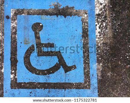 Disabled sign on concrete floor #1175322781