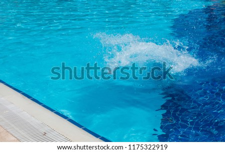A boy is jumping into the pool #1175322919