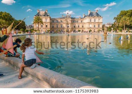 Paris France September 2018, Le Jardin Luxembourg during summer, people play in the park with sailing boats #1175393983