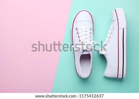 Pair of white sneakers on colorful background #1175412637
