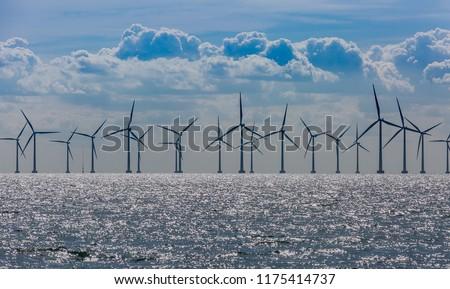 Windmills in the sea. Wind power. Green energy #1175414737