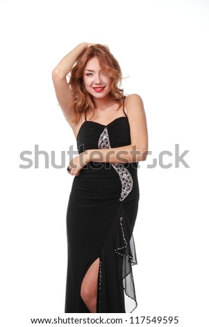 Studio image of elegant woman in black dress having fun, isolated on white/girl in black dress in studio #117549595