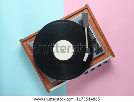 Vinyl player on a blue pink pastel background. Top View #1175514865