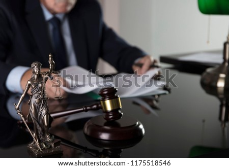 Law and justice concept. Male judge on gray background, statue of justice, gavel, bokeh. #1175518546