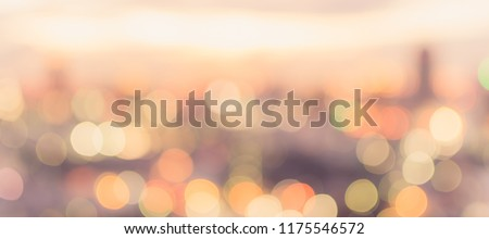 Golden hour sky with city rooftop view blur background with cityscape business corporate office building landscape blurry twilight night lights skyline nightlife bokeh for evening party  #1175546572