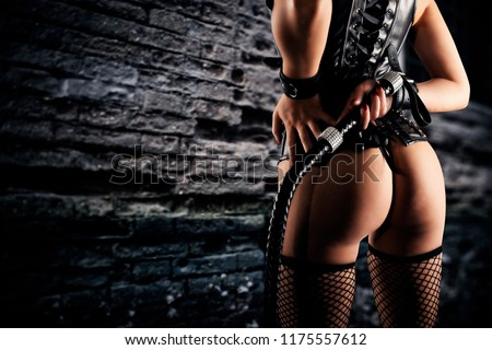 Sensual provocation of a sexy bdsm woman with whip #1175557612