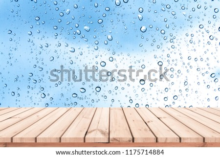 Wood plank with abstract water drop on glass background for product display  #1175714884