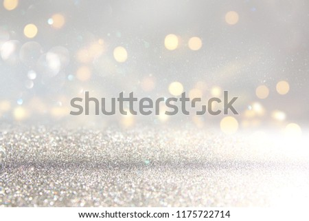 glitter vintage lights background. silver and white. de-focused #1175722714