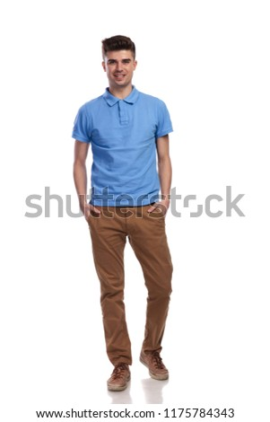 full body picture of a smiling casual man standing with hands in pockets on white background #1175784343