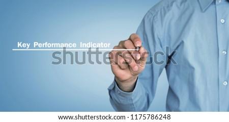 Man writes Key Performance Indicator text on screen. #1175786248