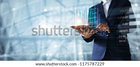 Businessman using tablet analyzing sales data and economic growth graph chart.  Business strategy. Abstract icon. Digital marketing. #1175787229