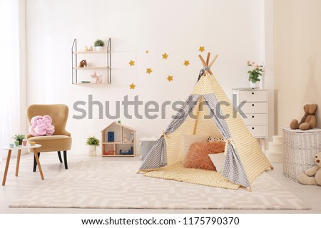 Cozy kids room interior with play tent and toys #1175790370