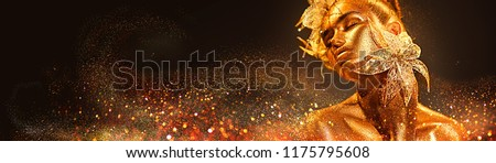 High Fashion model woman with bright golden sparkles on skin posing, fantasy flower, portrait of beautiful girl glowing make-up. Art design gold sequins make up. Glitter glowing golden skin, jewellery #1175795608