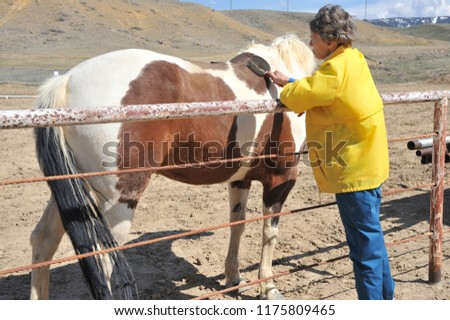 Female rancher and her horse bonding on the ranch outdoors. #1175809465